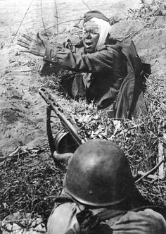 Russian soldier with a PPSH and a wounded German.
