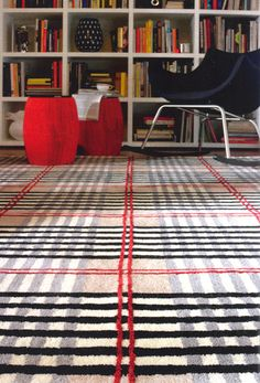 not in love with the colors, but in love with the idea of a tartan rug.