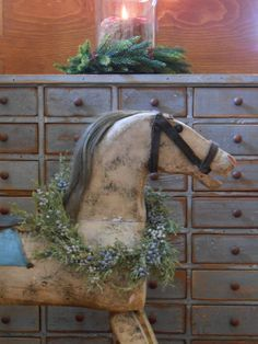 We had one of these horses at our grandfather's farm that we played with as kids. Primitive Christmas, Country Christmas, All Things Christmas, Christmas Home, Vintage Christmas, Xmas, Christmas Colors, Antique Rocking Horse, Vintage Horse