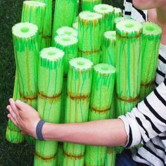 Bamboo Stacking Game: An even number of green pool noodles (10 or 12), knife (maybe don't use your fancy one), Permanent markers in shades of brown & green. Take turns adding layers to the stack, or simply play as a one-person challenge game.