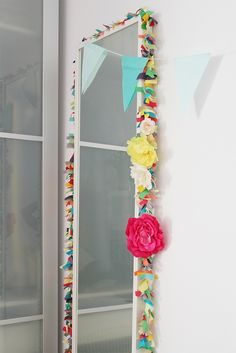 How gorgeous does this fabric flower garland make this $5 mirror look? Perfect way to dress up a kids room on the cheap