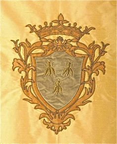 French crest with bee's using velvet and silk applique and bonaz stitching
