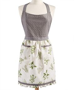 A fresh look in rustic charm, this Love the print and style of this apron! Farmhouse apron from Martha Stewart Collection features an embroidered bodice trimmed in an earth-tone print. #apron #apronology #cooking #marthastewartcrafts #baking #kitchen #Farmhouse #affiliate