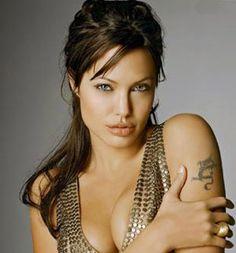 Google Image Result for http://tvwriter.net/wp-content/uploads/2012/07/Angelina-Jolie-in-gold-dress-tm.jpg