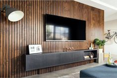 Unique Endurapanel panelling system gives the appearance of a traditional slat wall or ceiling. Panneau Mural Tv, Tv Wand Design, Tv Wanddekor, Tv Feature Wall, Modern Tv Wall Units, Living Room Tv Unit Designs, Tv Wall Decor, Asian Home Decor, Slat Wall