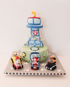 Paw Patrol themed cake with all the cars and tower