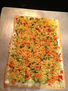 Fresh Veggie Pizza  Recipe Below:  Crescent rolls spread out and cooked according to package.  Mix 3oz cream cheese, 3oz sour cream, and 2 tsp. of hidden valley buttermilk ranch powder.  spread on cooled crescent rolls.  Top with chopped fresh broccoli, cucumber, carrots, and red pepper.  Sprinkle with shredded cheese.  Yum!