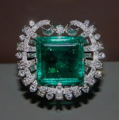 The Hooker Emerald, discovered in the 16th or 17th century, weighs 75.47 carats. It measures 27 mm to a side & is remarkably free of inclusions for its size. The gem's cut gives the appearance of a series of concentric squares within the gemstone. Janet Annenberg Hooker donated the brooch to the National Museum of Natural History in 1977, when it was valued at US$500,000. It is on display in the Janet Annenberg Hooker Hall at the Smithsonian Institution's in Washington D.C.