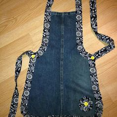 Recycled Denim Apron ~ Good pattern for leather wood carving apron This is cute. by dee Recycled Denim Apron - several different recycled denim projects here, but I especially LOVE the one pictured here! Denim jeans apron - link just goes to a photo Recyc Sewing Aprons, Sewing Clothes, Diy Clothes, Denim Aprons, Artisanats Denim, Jean Apron, Sewing Crafts, Sewing Projects, Sewing Hacks