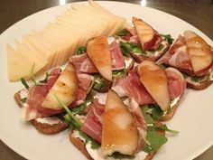 Proscuitto with goat cheese and plum topped with fig ginger jam