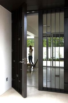 *entrance, screen door, modern design, black and white, outdoors*