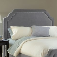 Wood-framed headboard with pewter velveteen upholstery and nailhead trim. Made in the USA.      Product: Queen headboard   ...