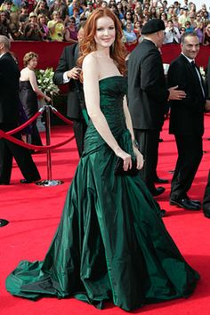 Green gown, pale skin and red hair -- gorgeous