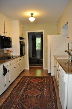 Maryland House updated kitchen with Chalk Paint® decorative paint by Annie Sloan.  on fridge and dishwasher...very kid friendly @ Annie Wilcox Designs
