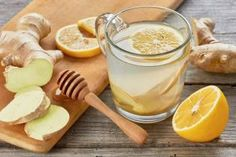 Ginger tee with lemon and honey on wooden table