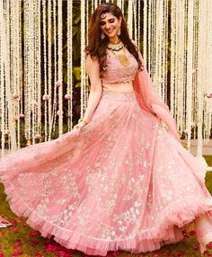 Luxurious fabric, intriguing embroideries and a dreamy sorbet pink lends an aura of pure love and happiness, like this feminine style by… Lehenga Choli Designs, Wedding Lehenga Designs, Designer Bridal Lehenga, Ghagra Choli, Gujarati Chaniya Choli, Wedding Designs, Indian Wedding Gowns, Indian Gowns Dresses, Indian Bridal Outfits