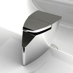 """Niu Lavatory Faucet. Modern Collection. """"Designed by Good Design Award winner, Maurizio Duranti, Niu combines innovation and fascinating aesthetic for a truly unique look and feel. Shaped from a single block, Niu reveals an integrated lever and unusual spout that transforms the water into a sculptural waterfall. To release the flow, simply press down on the pointed end of the lever and rotate it smoothly in both directions to obtain the desired temperature"""" Maurizio Duranti"""