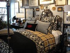 Awesome bedroom!  Just look at that bed.  Love all the colors, the wall art, everything.