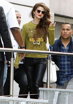 Glam Gomez Selena Gomez rocked her wavy, lighter tresses in Paris May 28.