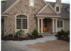 certainteed cedar impressions vinyl siding in natural clay. Note different exterior looks on this house. Metal, rock, horizontal and vertical siding. House, House Front, House Siding, Stone Siding, House Exterior, Building A House, Stone Exterior Houses, Exterior Stone, Rustic Exterior