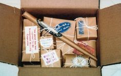 Wrap presents in brown packaging paper, address to recipient from the desk of…