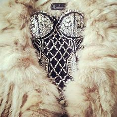 The fur, crystals, diamonds, and black leather helps to tie together many ideas i can bring to the room