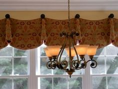 a simple scalloped valance  Use this as the valance for dining room  made from the red suede