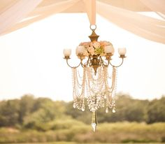 Crystal wedding chandelier with flowers and candles - European vintage wedding