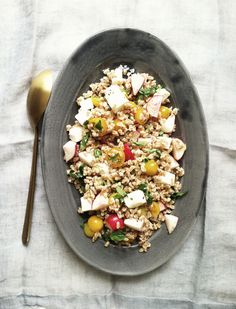 Fresh farro salad with tomatoes, radishes, basil, and feta