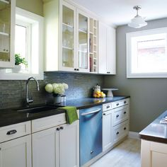 black counter tops, white cupboards, gray walls,  green accents = MY KITCHEN! :D
