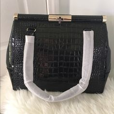 "Kate Spade Handbag Sexy, sleek shoulder bag with crocodile embossed patent cowhide. 14k gold plated hardware, turnlock closure, double slide pockets, and interior zip pocket. Drop length is 7.5"". ✨Also available in Beige color, will list soon. Buy, Reasonable Offer, or Bundle for extra discount!  kate spade Bags Shoulder Bags"