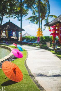 Brilliant use of umbrellas in wedding decor. Colourful and funky.