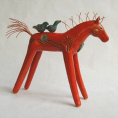 Ceramic horse sculpture with tree design and bird (large view)