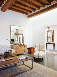 It is freezing in California. I'm not complaining, especially after it was startingto feel like Indian summer had overstayed it's welcome. But I can't help but swoon over this breathtakingestate in Ibiza. The white washed walls, exposed wood beams, cement poured floors andthatched outdoor