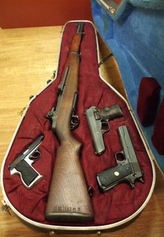 Interesting use for a guitar case. I never imagine an M-1 Garand would fit in one.