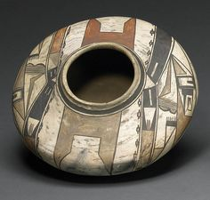 A Hopi polychrome jar | A four-color example, painted in a bold pattern of opposing split-limb projections alternating with complex compositions of symbolic forms and geometric complements.