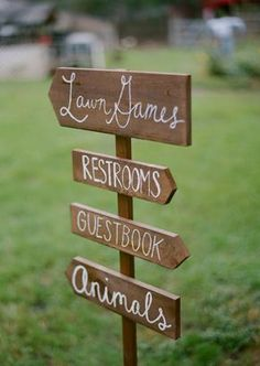 Outdoor wedding directions sign. Giant Jenga for a lawn game... search that shit!