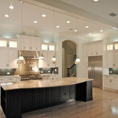 Jeff Reed for Fox Signature Homes - Jeff Reed, Cabinetry Designer for Fox Signature Homes. Kitchencraft Integra Lexington Alabaster with Pew...
