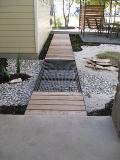 This is exactly what I'm picturing along the back of the house. A wood deck with metal grate panels like this installed above basement window wells. Landscape Metal Grating Design, Pictures, Remodel, Decor and Ideas Landscaping Austin, Modern Landscaping, Backyard Landscaping, Landscaping Ideas, Backyard Designs, Backyard Ideas, Wooden Walkways, Wooden Decks, Modern Landscape Design