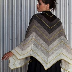 Bold chevrons energize this modern shawl pattern from designer Grace Anna Farrow. Waves of color flow along a shimmering neutral palette. Pick your pop of color when you knit yours in Knit Purl's exclusive Glow Lace, for a project that is soft, sleek, and sophisticated.