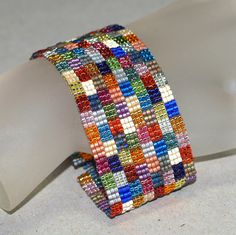 Handmade peyote bracelet in metallic beads.