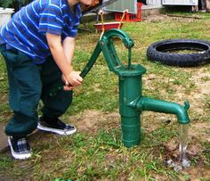 rain water tank + water pump = sustainable water play. This would be well loved by my boys!!