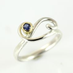 Double curl ring with sapphire Handmade. Delicate, little ring, which holds a sapphire in a golden ball