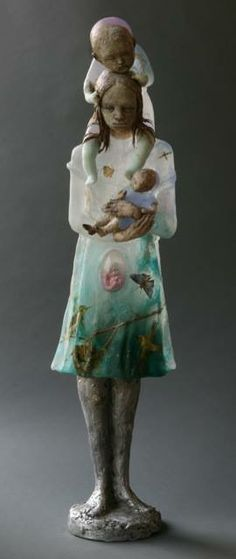 "Made by: Christina Bothwell , ""Memoir"" -  56 high, cast glass, cast aluminum, raku clay, oil paints, found objects. Made in: 2013"