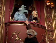 UK Spot: Sam, believing Statler and Waldorf to be more distinguished than the other Muppets, has taken to the balcony to interview them. While he is able to interview Statler, both are unaware that Waldorf has fallen out of the box and is desperately clinging to its edge.