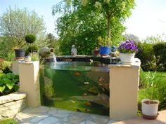 These above ground koi pond with window ideas will totally inspire you to bring your backyard into a whole new style! Outdoor Fish Tank, Outdoor Ponds, Ponds Backyard, Outdoor Gardens, Fish Pond Gardens, Back Gardens, Koi Pond Design, Garden Design, Above Ground Pond