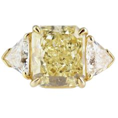 Cartier 4.05 Carat Fancy Yellow Diamond Ring | From a unique collection of vintage three-stone rings at http://www.1stdibs.com/jewelry/rings/three-stone-rings/