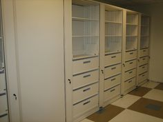 Rotary Storage Cabinet with empty drawers and shelving for storage. With multiple inserts in the rotary cabinet, shelves can be used to store books, files or binders will the drawers can provide added security to files or smaller items that can easily be lost on shelves. When rotated the cabinet can be secured by a keyed lock.