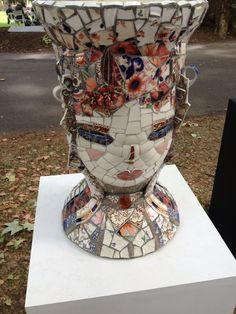 My friend Mary's mosaic head....pot plants and china...