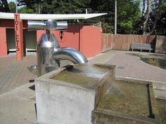 Sculpture of a water tap is centerpiece of a childrens water park at Queens Park in Invercargill, New Zealand.